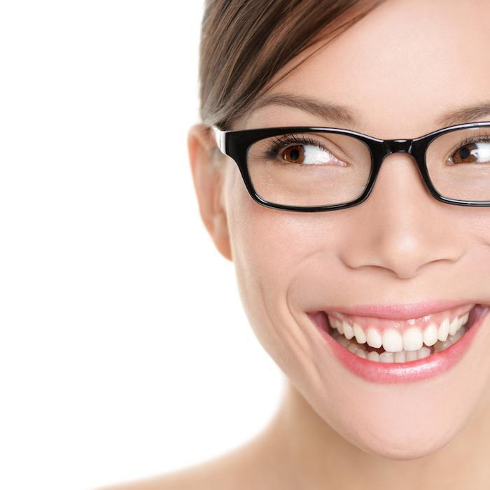 Closeup of a Woman Smiling With Glasses