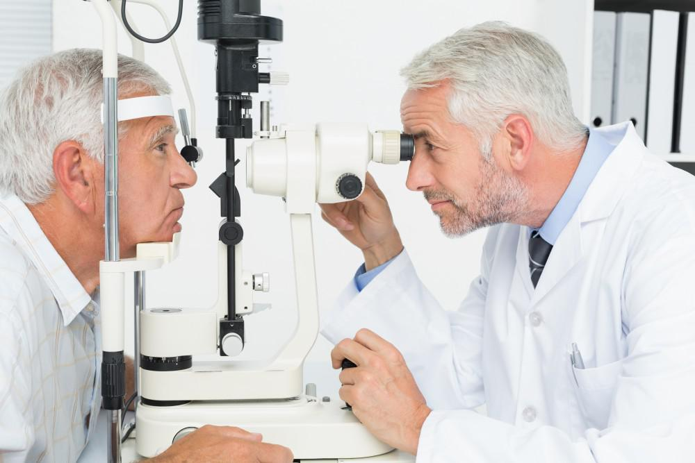 Doctor Giving an Eye Exam to an Older Man